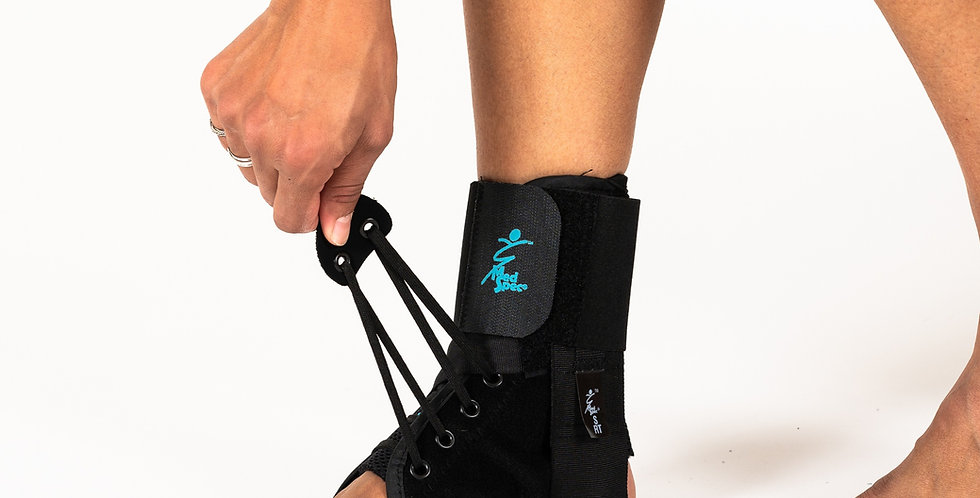 Side view of a woman pulling the strap of the ASO EVO Supinator ankle brace