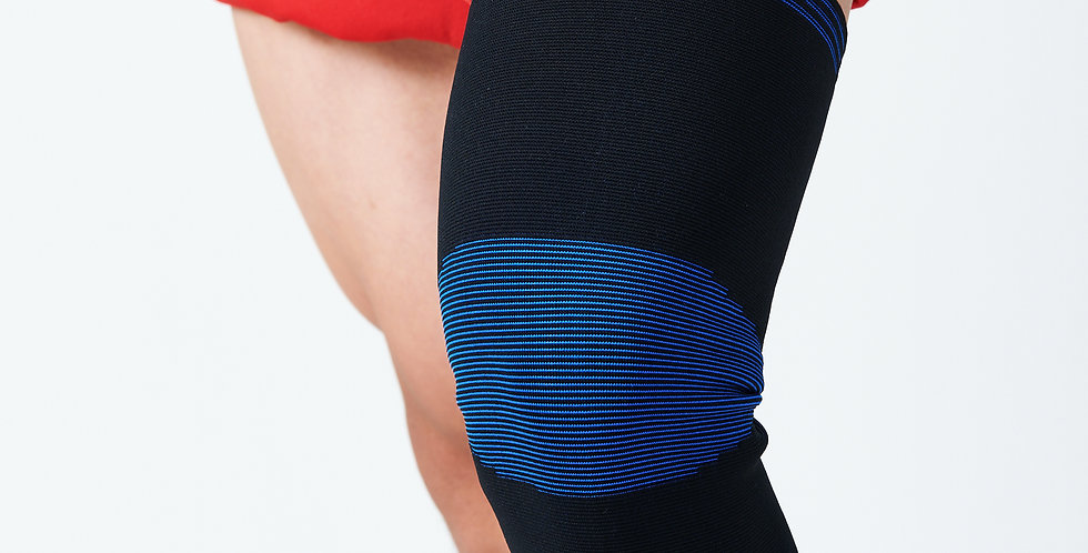 Close up of the black & blue Bort compressive knee sleeve on a knee to help with minor knee sprains and strains