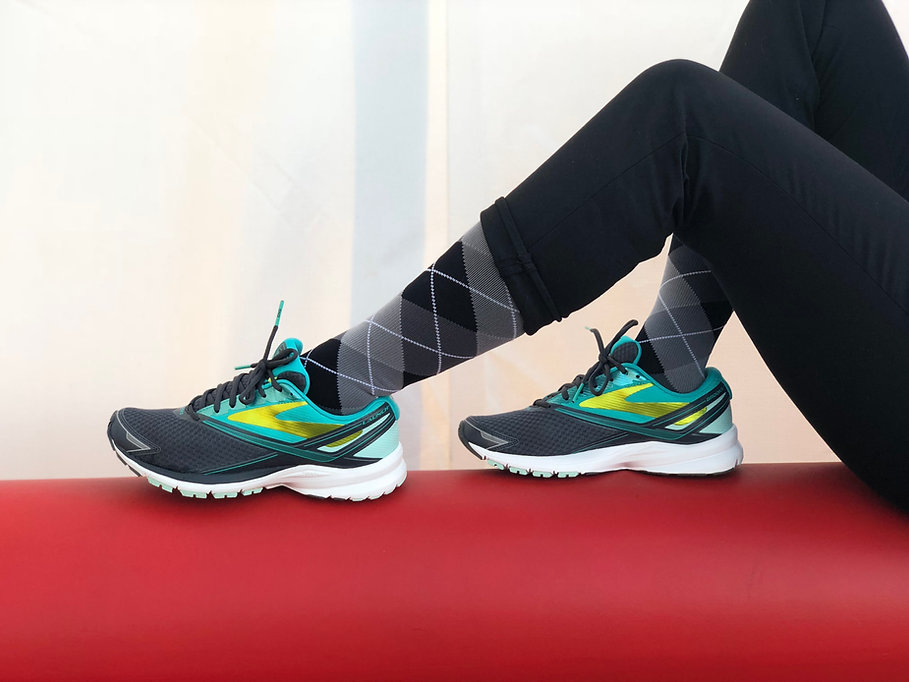 Close up of argyle compression socks and running shoes