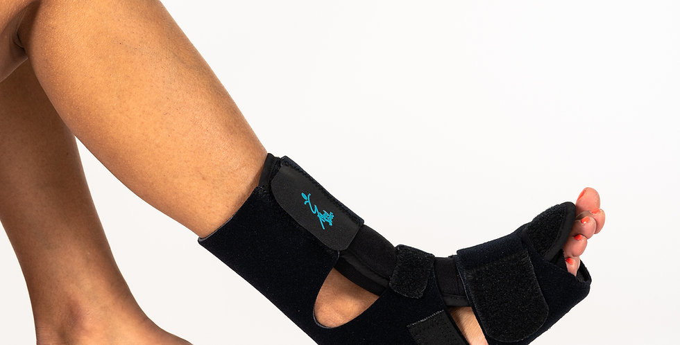 A foot with the heel down and toes up wearing the Med Spec Phantom Dorsal Night Splint for plantar fasciitis
