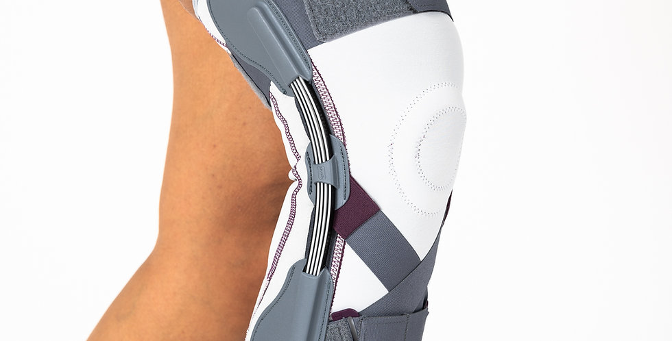 Close up of the grey Push Medical Hinged Knee Brace for mild ligament injuries of the knee on a slightly bent leg