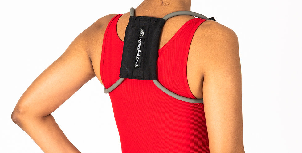 A woman in a red tank top is wearing the Posture Medic a posture corrector made of resistance tubing