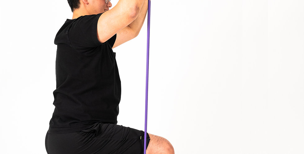 A man doing a lunge while holding the strongest resistance of purple Fit Tubes above his shoulder with his arms extended