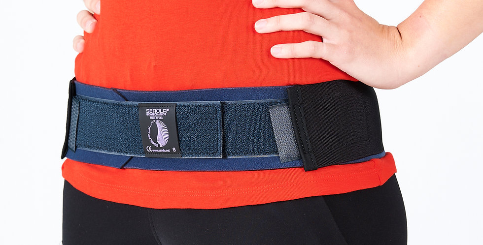 A woman wearing the Serola SI Belt for sacroiliac dysfuntion