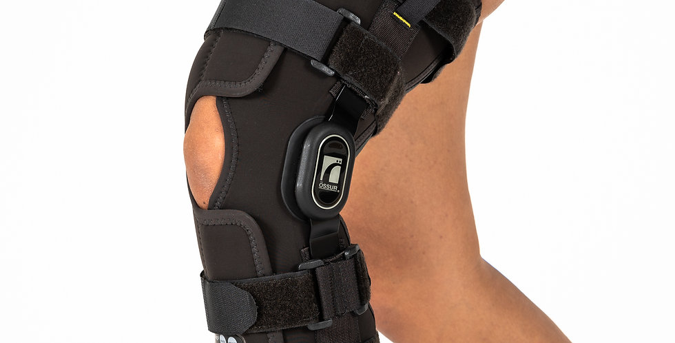 Knee in focus wearing the Ossur Rebound Range of Motion knee brace to help recover from a moderate to severe ligament injury