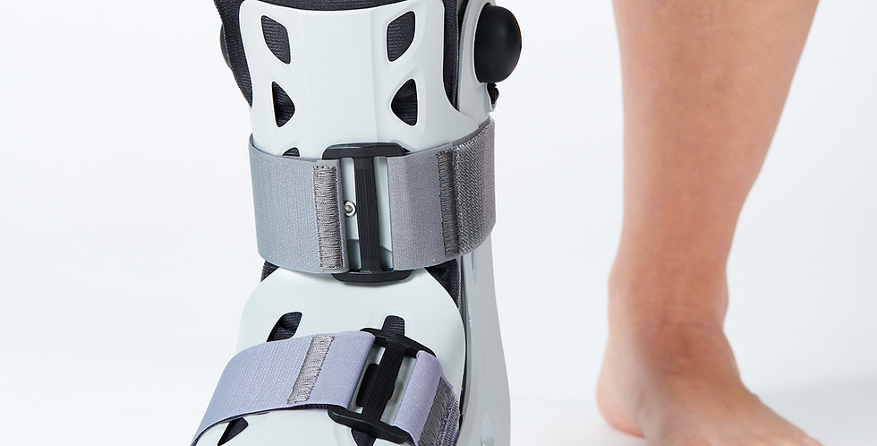 Close up someone wearing the Aircast AirSelect Short Walker Boot a cast alternative to heal forefoot fractures