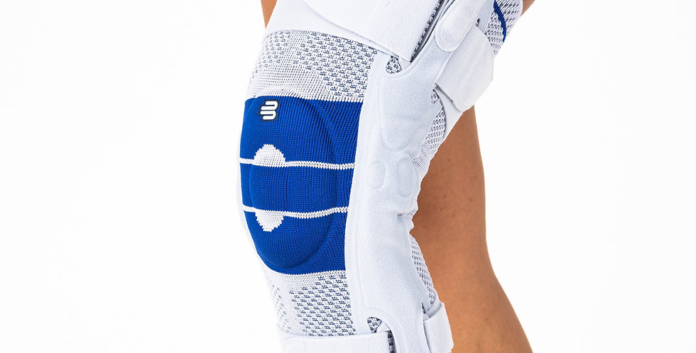 A grey and blue Bauerfeind GenuTrain S Hinged knee brace with metal hinges for ligament support on a slightly bent leg