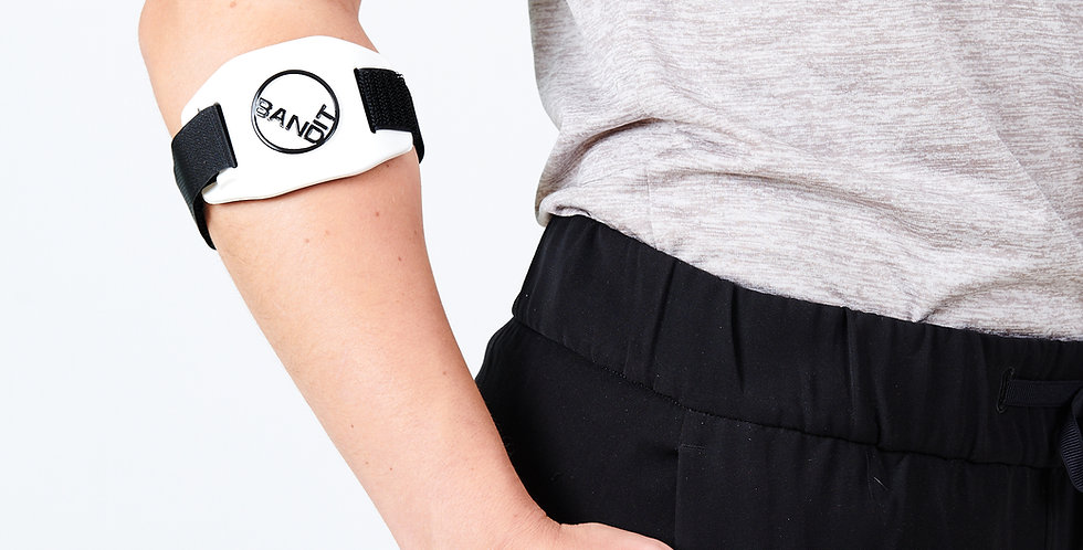 A slightly bent arm with hand in pocket wearing the Band-it elbow strap for golfer's and tennis elbow