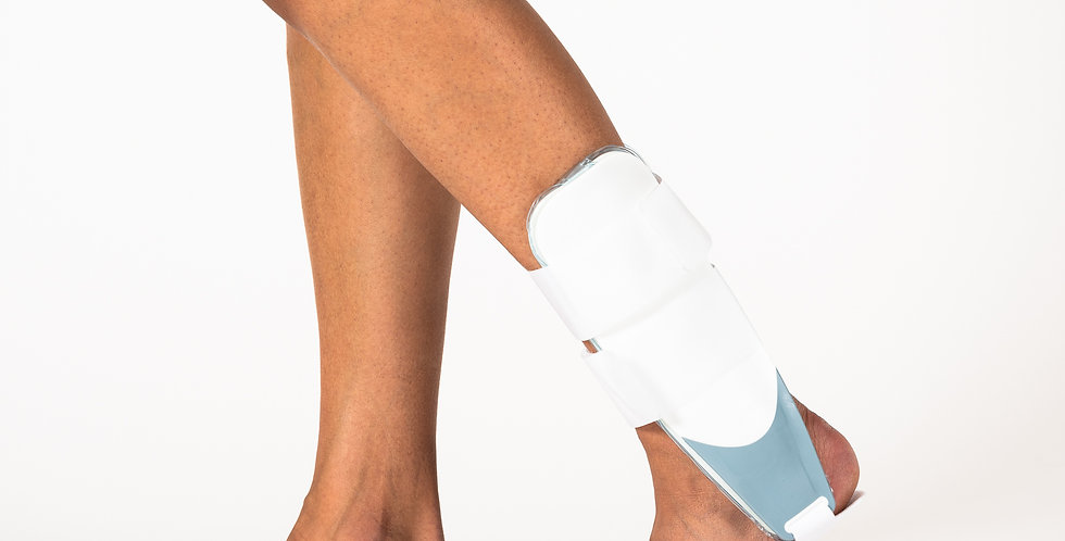 Close up of leg wearing the Ossur Airform Stirrup pneumatic ankle brace with rigid plastic stays for severe ankle sprains