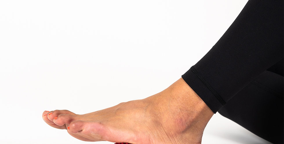"""A foot with the Paris 2"""" massage ball underneath in the arch area to provide relieve from plantar fasciitis"""