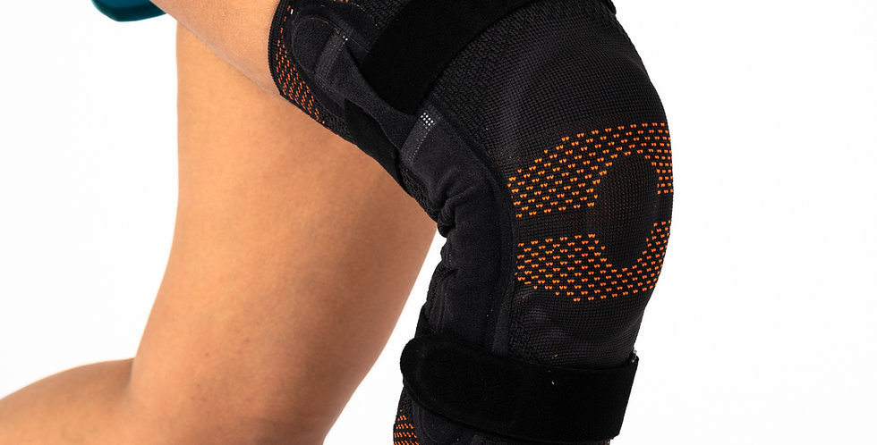 A bent knee wearing the Orliman Rodisil knee support with metal hinges to recover from and prevent knee ligament injuries