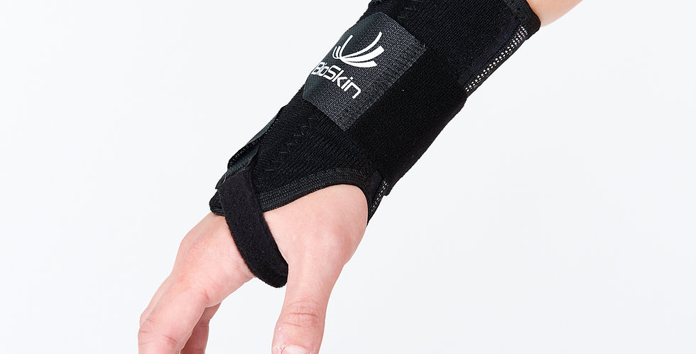 Close up of an arm and hand wearing the Bioskin Wrist brace for tendonitis or carpal tunnel syndrome
