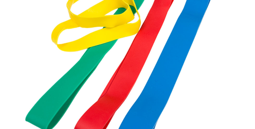 Top down view of four resistance bands in yellow, green, red and blue used for strength training