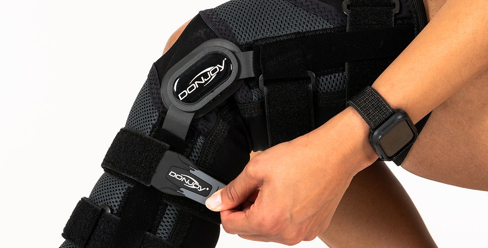 Close up of the Donjoy Playmaker II Ligament knee brace with metal hinges for ACL, PCL, MCL, and LCL injuries