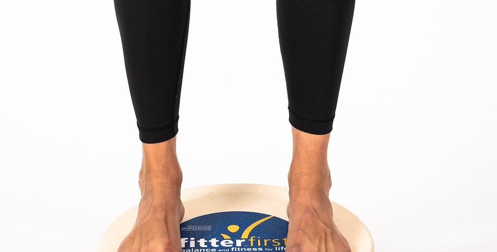 "Woman standing on a 16"" wooden circular balance board by Fitter First to rehab her sprained ankle"