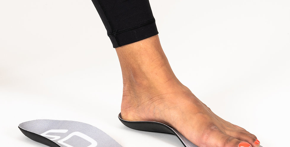 A foot resting on top of a Sole insole an arch support that fits casual footwear for relief of heel pain & plantar fasciitis