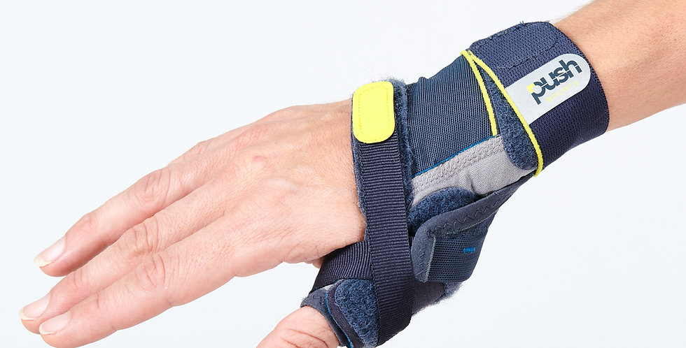 Close up of a wrist and hand wearing the Push Sports Thumb Brace to immobilize the thumb joint