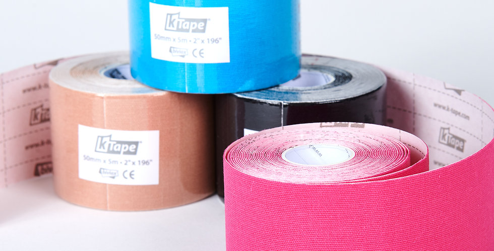 Rolls of beige, blue, black and pink K-tape which provides pain relief from musculature injuries