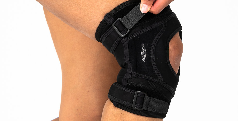 A woman closing the thigh strap of the Donjoy Tru-Pull Lite for mild to moderate subluxation