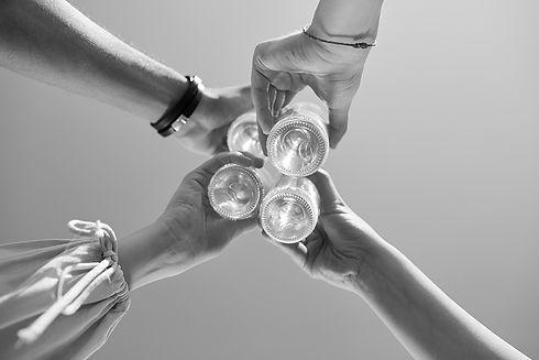 Clinking-bottles-against-blue-sky-542832