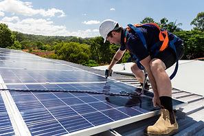 Solar panel technician with drill instal