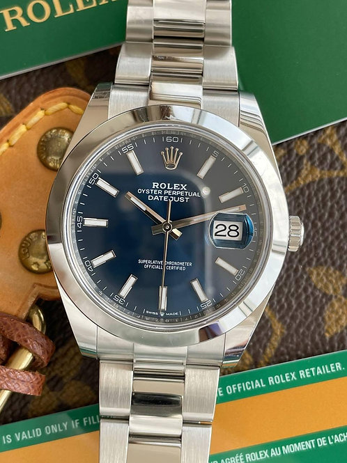Rolex  Ref 126300 with papers