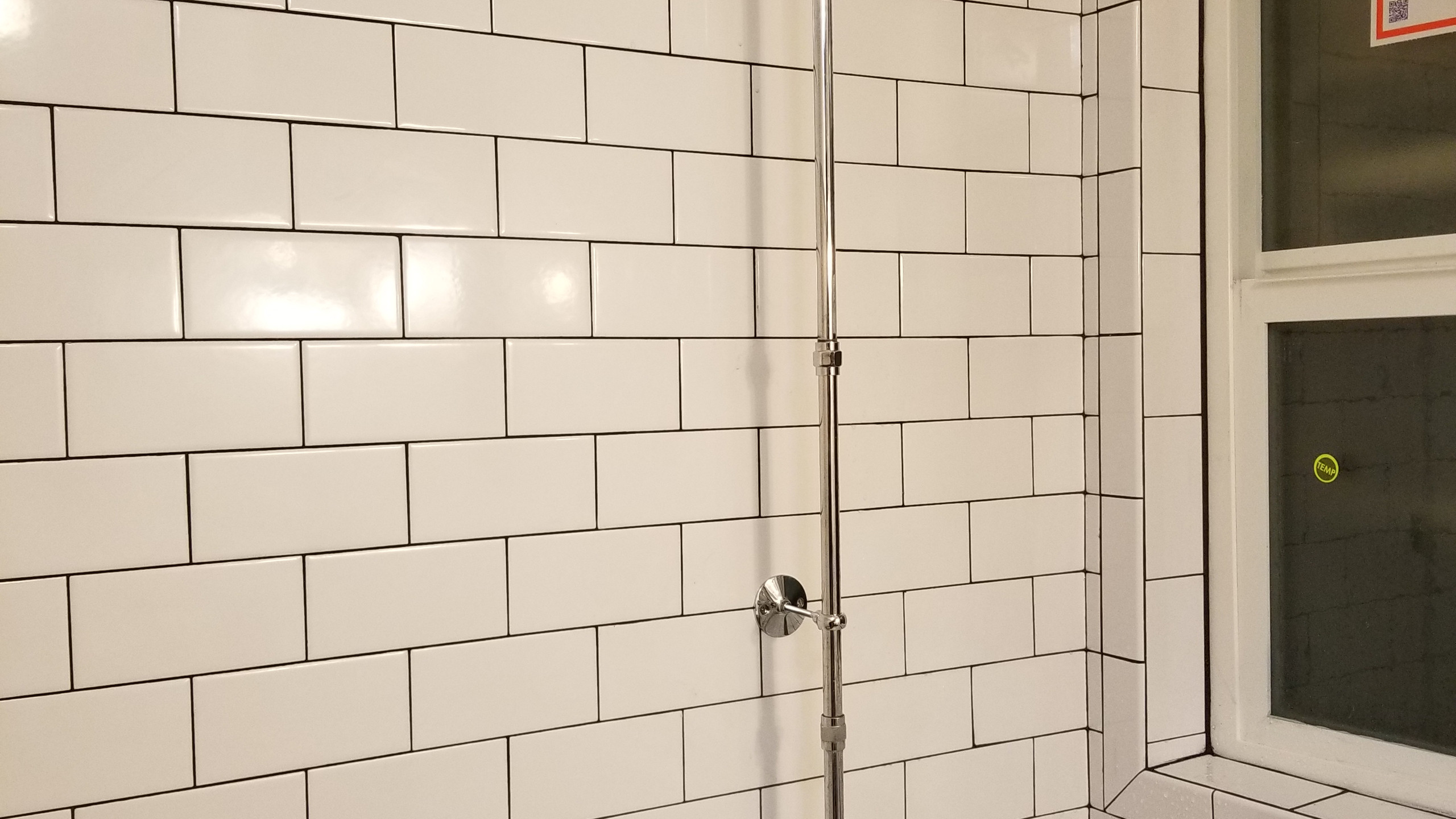 "Here we installed a 12"" extension for the shower riser and also installed two brackets to secure the riser."