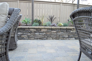 Appease Builders., leadges, flower beds and accents