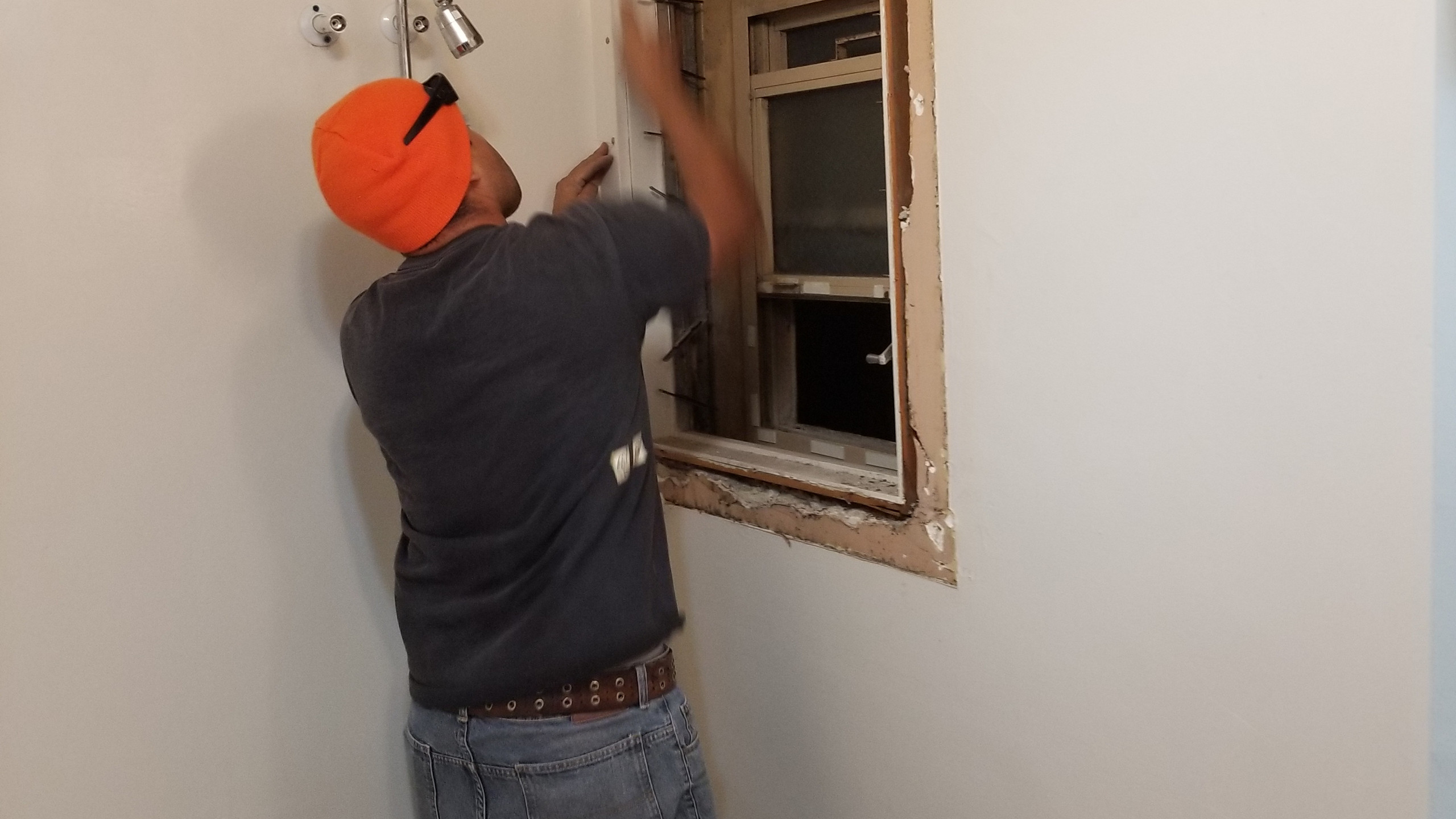 Removal of the interior window, while leaving in place the metal exterior window