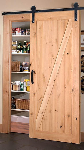 Appease Builders, a rustic barn door as charactor to a home