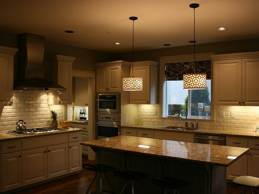Recessed lighting installation by Appease Builders