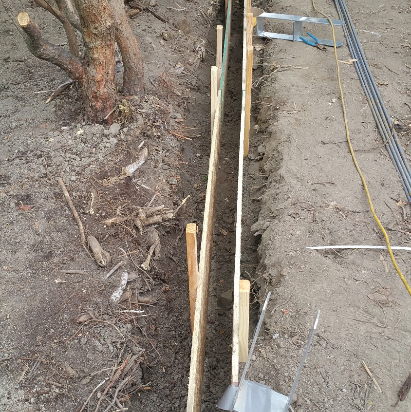 Because it's a smaller footing, we used OSB for the form... next time I'll stick to 2x4's... or 2x6's
