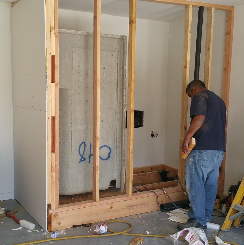"""This is a small bath that will have a shower enclosure, toilet, 18"""" cabinet and sink, medicine cabinet with mirror and an exhaust."""