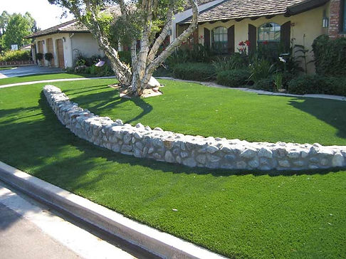 Appease Builders, Synthetic turf and stone accent wall