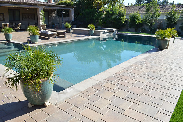 Appease Builders., pool side interlocking paver installations