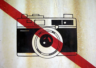 Very old sign that forbids photo cameras