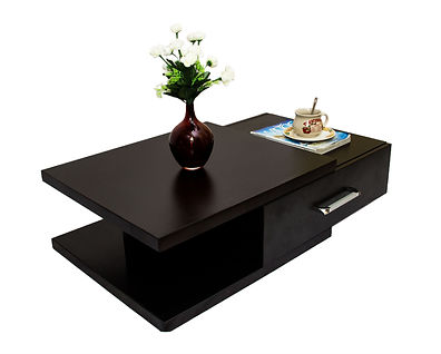 Dam coffee table is designed for elite with substantial quest for high quality finish and durability. A statement of class in your living room and office reception.  It is 1400X600X280MMH with a storage unit. Available in Wenge (brown) and white laminate.
