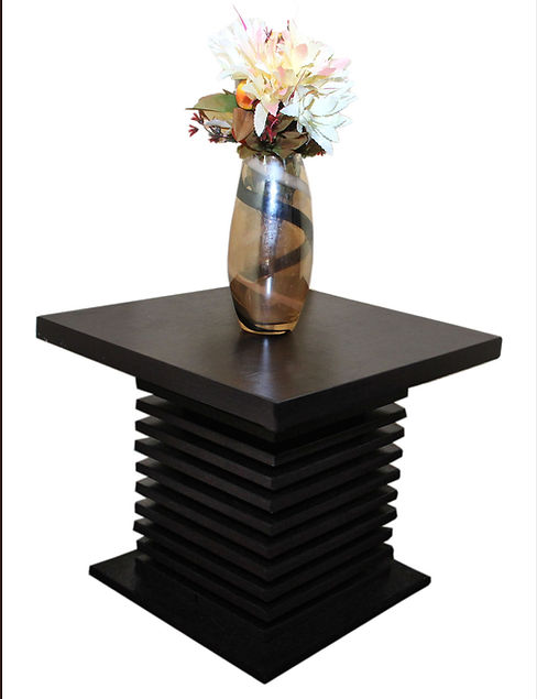 Slat Side table is unique for its elegance and durability.  A 500X500X430MmH side table with strips of laminated high density fiber boards.
