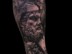 Black and grey realism tattoo by Kiwie Mauri