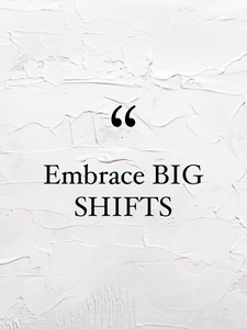 """A white textured wall with black words reading """"Embrace Big Shifts"""""""