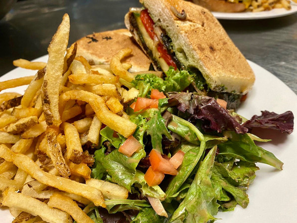 Pressed vegetable sandwich with added French fries