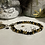 Thumbnail: Bracelet Perles facettes Noir et doré