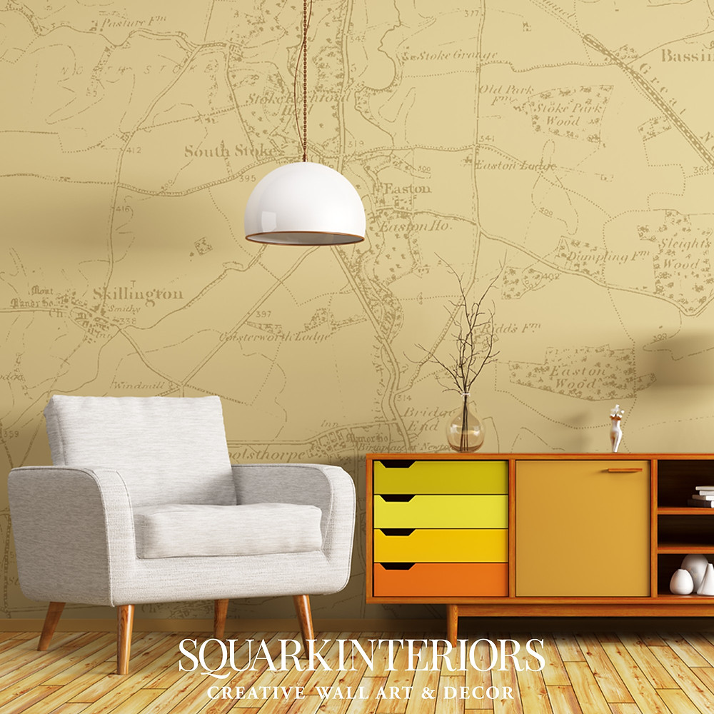 Squark Interior vintage map wallpaper behind a chair and cabinate
