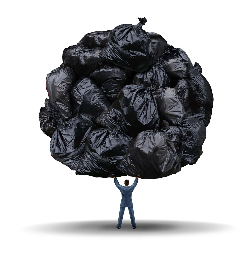 Back view of a business man holding up loads of bin bags.