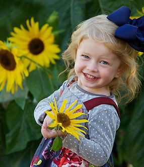 Little Girl with Flower Photo
