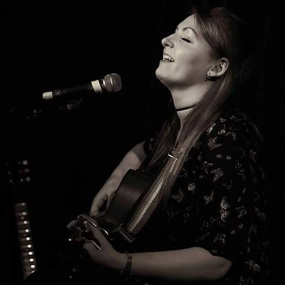 """With the weather forecast distinctly gloomy, where better to be then The Green Note. For some months #TeamW21 have been monitoring when Lucy Zirins would next be playing London. Tonight's show is a repeat of one that occurred back in August 2015, with just the playing order be the only difference. The Will Shackleton Trio got things started with an enjoyable set, initially just playing solo he got everybody at ease with a version of """"Everybody's Talking"""" and continued in a similar vein when joined by a bassist and drummer.  It was good stuff including a Leonard Cohen cover of """"Tonight Will Be Fine"""" but it was not the reason for the visit. Lucy hails from Burnley, if you were not aware before they you could probably have guessed after a welcoming """"Ow do!"""" as she settled to play on a somewhat short stool. Kicking off with a new song """"The Right Side Of Wrong"""", it was immediately apparent that this was someone who could both play and sing well even if she was shortly later to admit that she was feeling a little nervous due to the intimacy of the gig. Her EP comes with a fine band backing her, so it good to report that playing solo the songs still stood up well in this raw format. The EP as Lucy was to explain was a direct response to her leaving Lancashire for the bright lights of London, the title track """"What's In Front Of Me"""" takes on additional meaning when you know that back story and played solo made it even more personal. It was a nice mix of familiar songs and strong new compositions, """"Close To The Wire"""" was one such new song with by her own admission had a lot of tricky picking in it!. One of the highlights, of the EP, is """"Falling To Pieces"""", a good country title if ever there was one, was to follow perhaps played slightly faster than the EP due to a touch of nerves, it was however simply breath taking, the vocals perfectly catching the mood of the song. The more the set continued, it became hard to comprehend why it had taken so long to catch up with her. Thing"""