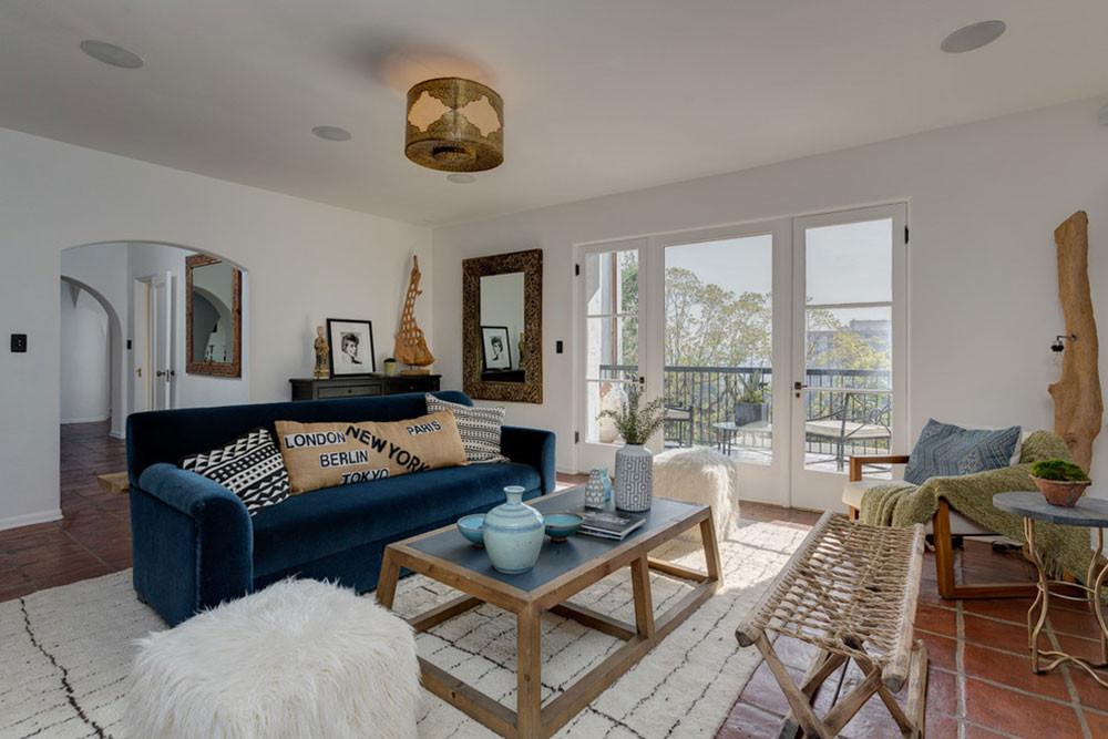 caribbean interior design, caribbean decor, beachy living room, coastal flooring, tile flooring, rattan furniture, neutral colors