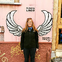 Image of young woman in fron of wall with wings on it