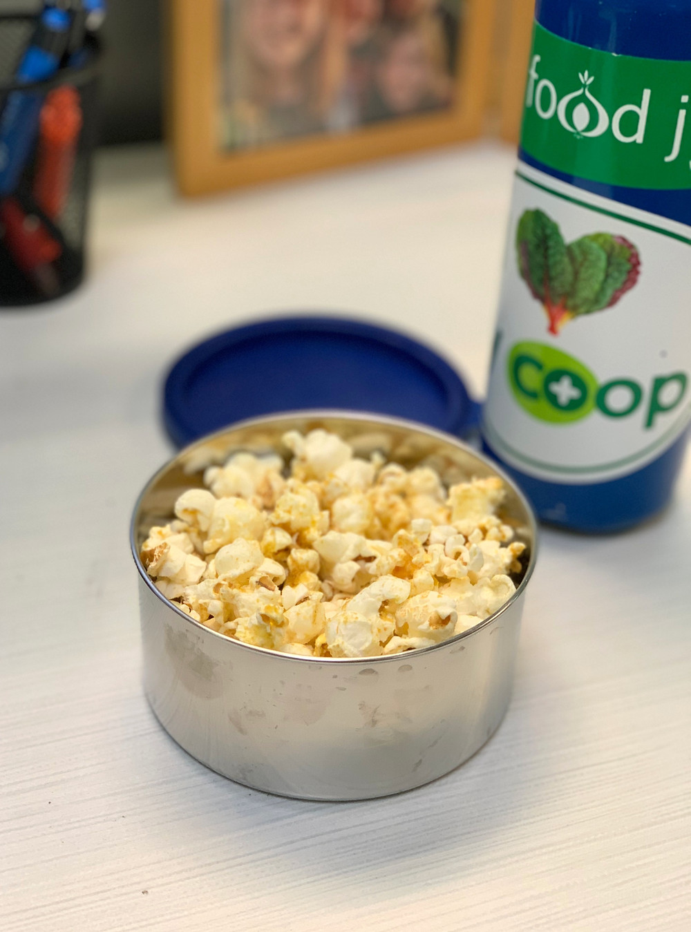 popcorn in a reusable container as a zero waste snack