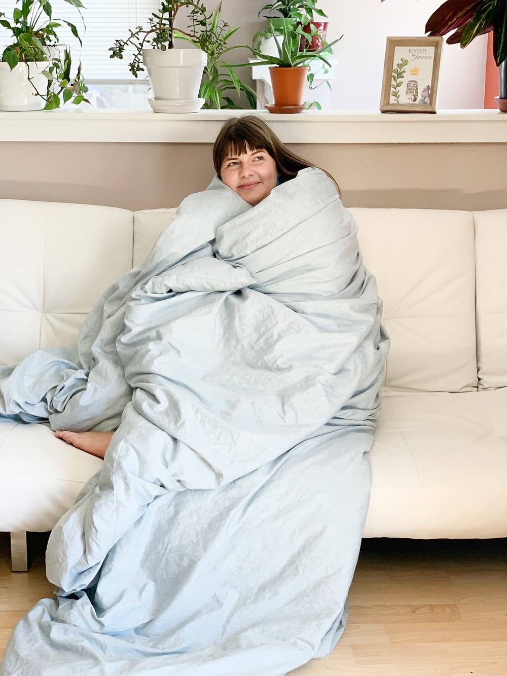 Jenica wrapped in her zero waste comforter